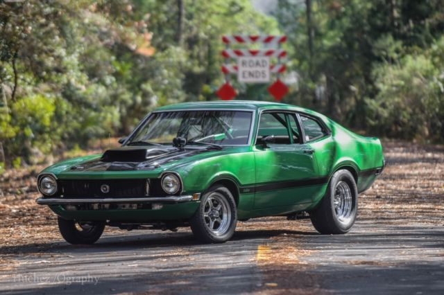 Green Ford Maverick  Car With Black Top